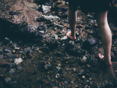 girls walks barefoot on a forest path, Unsplash